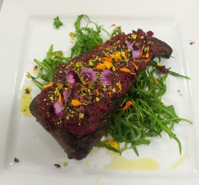 Fiery beef fillet with spiced beetroot pesto, pistachios and petals