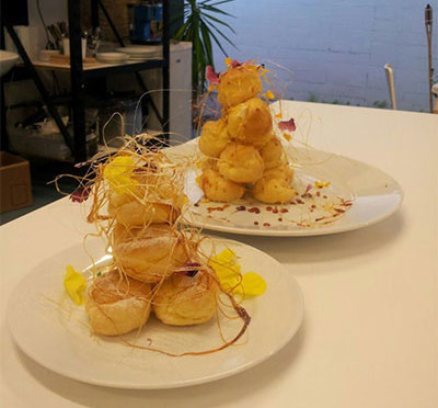 Mini croquembouche with petals, filled with Tahitian vanilla custard…