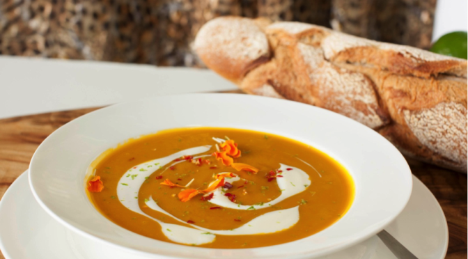 Saffron, lime and chili infused butternut broth with creamy chive and feta dollop